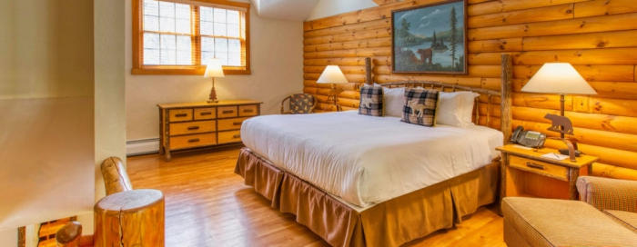 cottage style spa resort room with light wooden interior