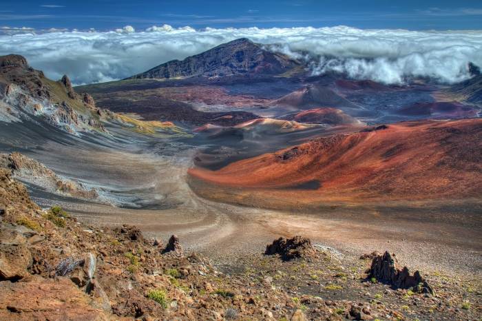 Haleakala Crater in Hawaii desert landscape colorful rocks clouds