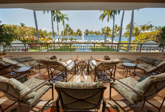 luxury spa resorts - terrace with a beautiful ocean view palm trees