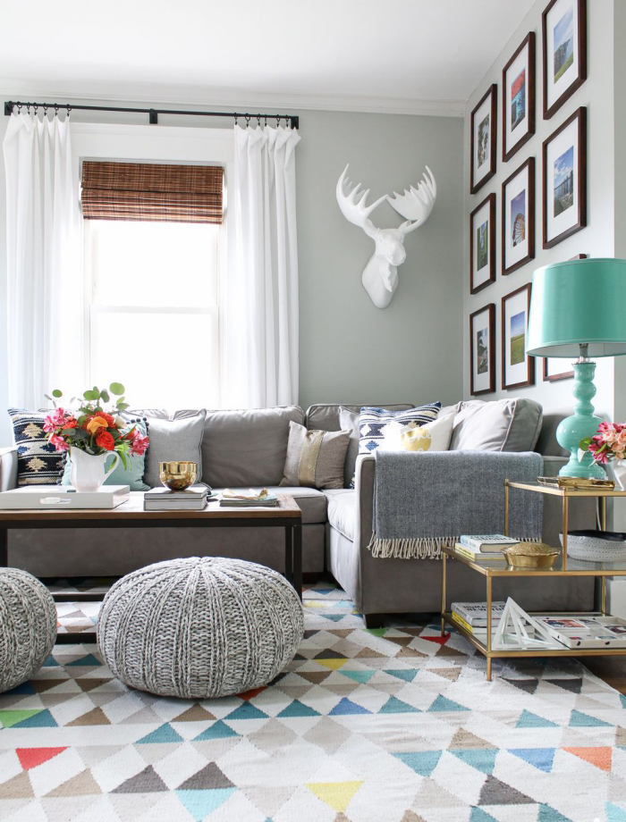 Grey and white Scandinavian living room with pops of color