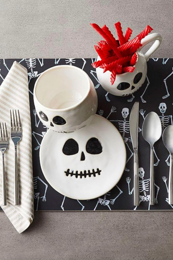 Halloween table decor with skulls and skeletons black and white