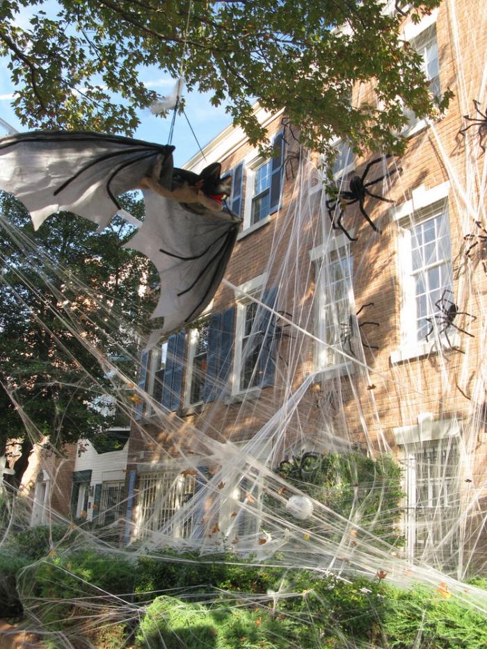 Huge outdoor Halloween spider web with spiders and bats