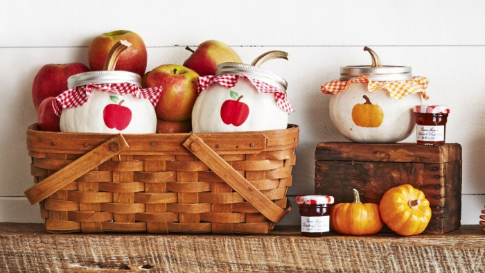 Baskets with apples and pumpkins and fall themed decorated jars