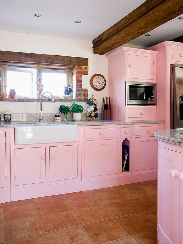 Soft feminine light pink kitchen with wooden elements