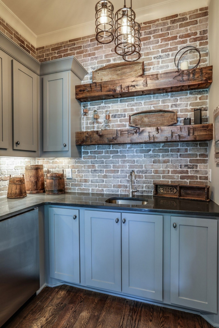 interesting basement kitchen with light grey cabinets and wooden shelves