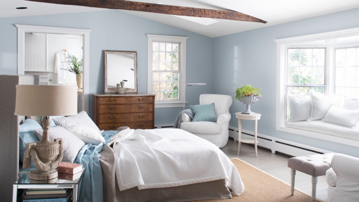 light spacious and airy master bedroom in light blue and crisp white interior colors