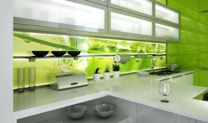 Green led backsplash in a modern white kitchen