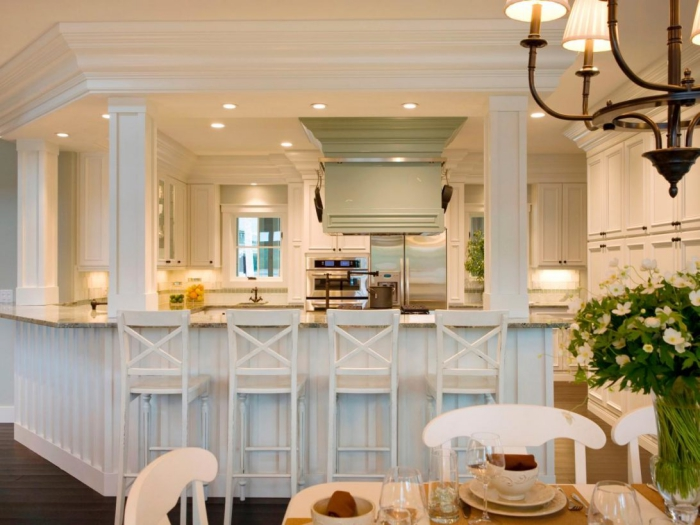 Kitchen cabinet lighting bar lights in an all-white kitchen