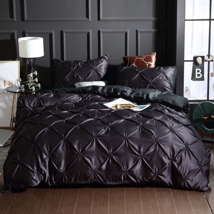 dark bedroom with luxury washed silk duvet cover set in black