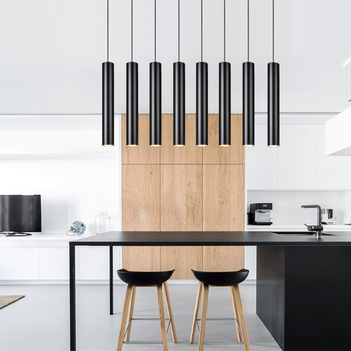 Modern sleek black pendant lights in a minimal contemporary kitchen with black accents