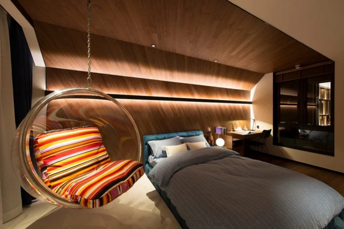 modern bedroom with wooden finish and ambient soft lighting