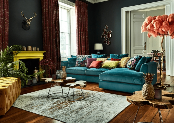 modern eclectic living room with dark walls and colorful accents bright yellow fireplace and turquoise sofa