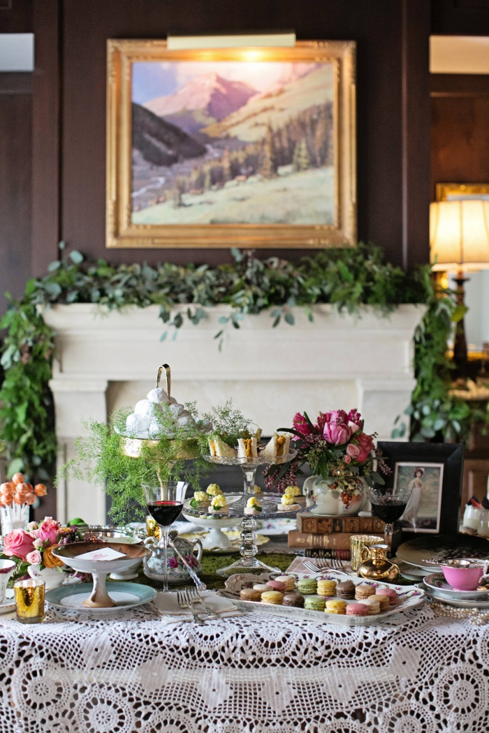 Beautiful luxury hotel interior afternoon tea table with a fireplace in the background