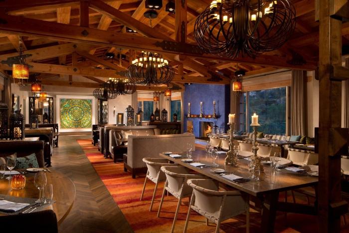 Restaurant interior in Rancho Valencia in California wooden interior chandeliers