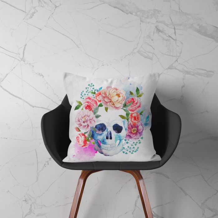 Light cushion on a chair with a skull and flowers