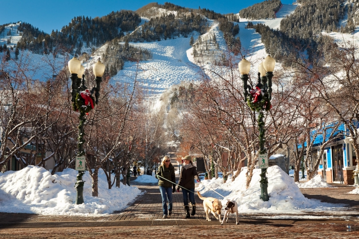 Spending Thanksgiving at St. Regis Resort Colorado snow slopes two women walking dogs