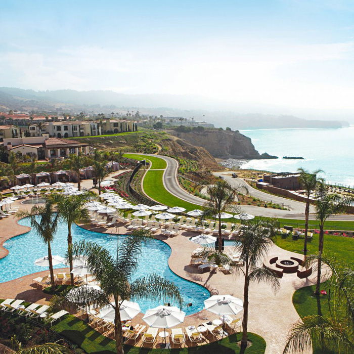 Terranea Resort in California outdoor sea view with palm trees and a pool