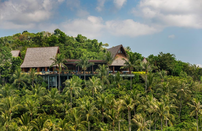 The Spa - Four Seasons Thailand in the middle of a tropical forest with tall palm trees