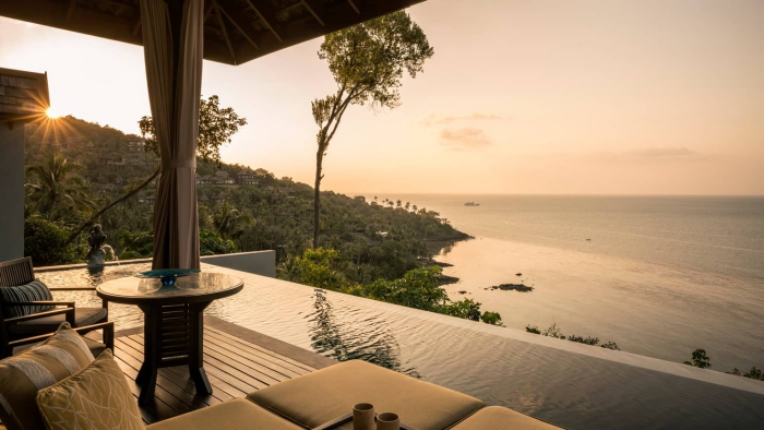 Beautiful sunset sea view from a hotel terrace with infinite outdoor pool area