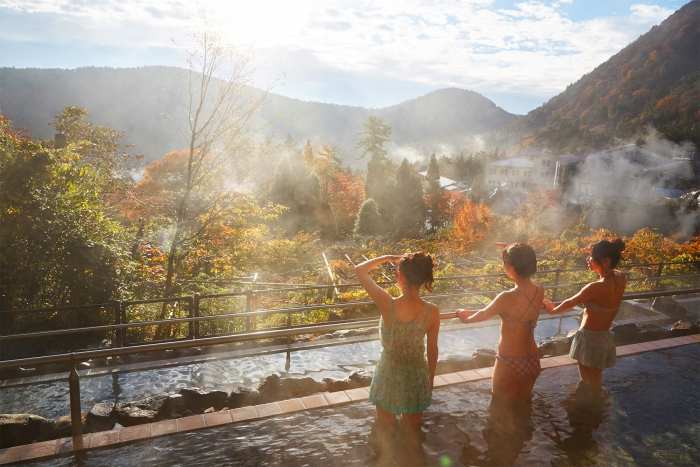 Yunessun Spa Resort Japan exotic spa treatments three women in hot water terrace with view over a forest