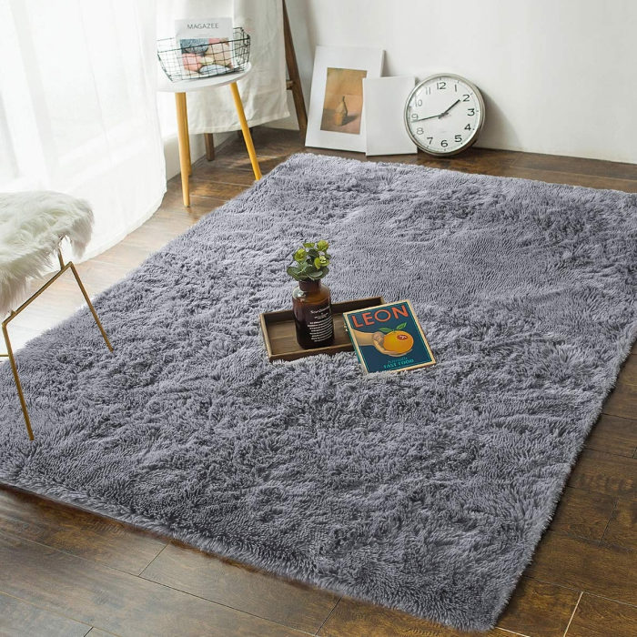 soft comfortable grey bedroom rug on a wooden floor