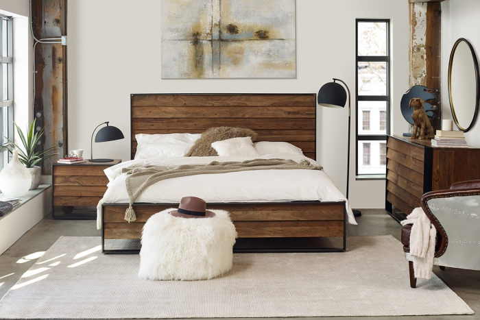 modern bedroom with wooden bed and furniture soft ottoman and abstractart