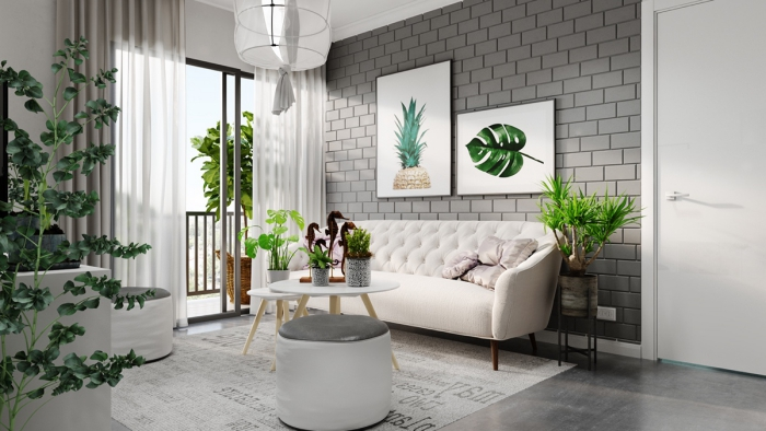 Living room area in white and grey with botanical motifs large window and plants