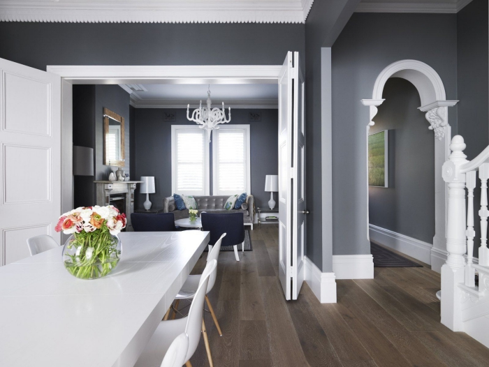Elegant traditional dining and living area in dark grey and contrasting white