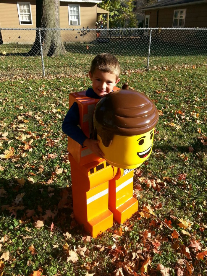 Little boy with a LEGO Halloween costume in a yard