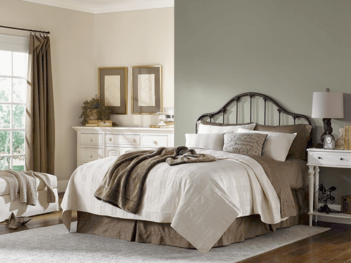 Master bedroom in traditional design style in calming shades of cream, white and grey