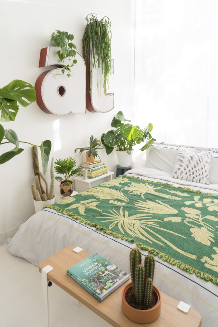 green potted plants in a white bedroom