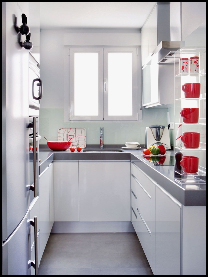 small white kitchen with red accent details