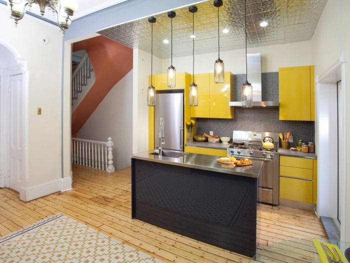 small modern colorful one-unit kitchen in yellow and metallic
