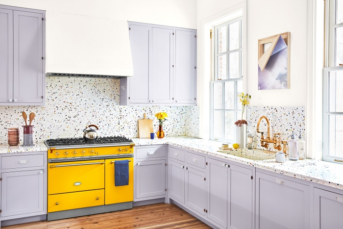 beautiful kitchen in grey with white bright yellow oven
