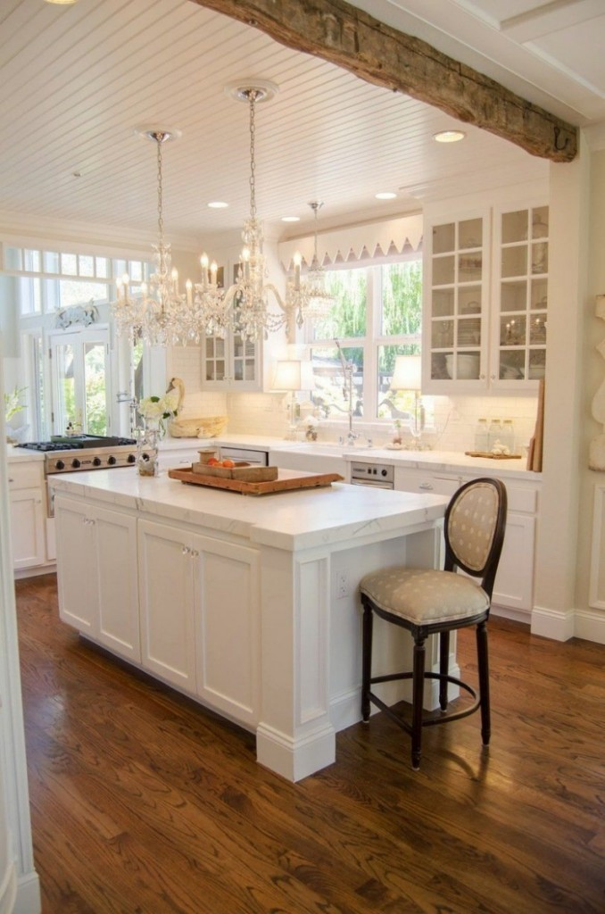 Glamorous kitchen design with vintage vibe and two crystal chandeliers