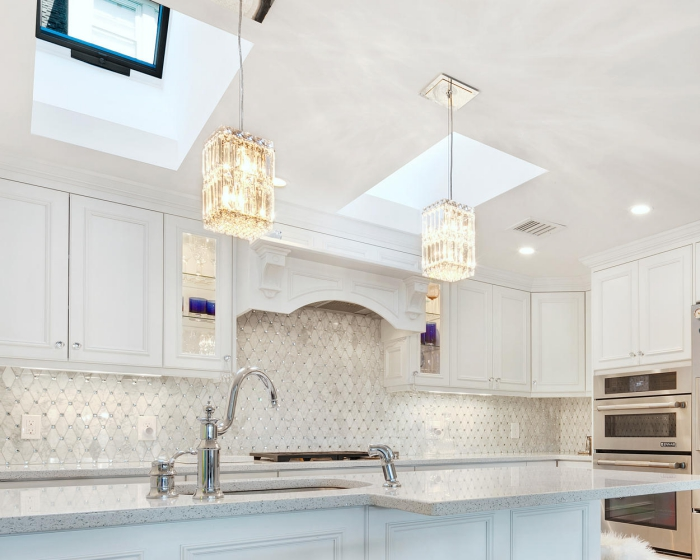 Glamorous White Kitchen with crystal pendant lights