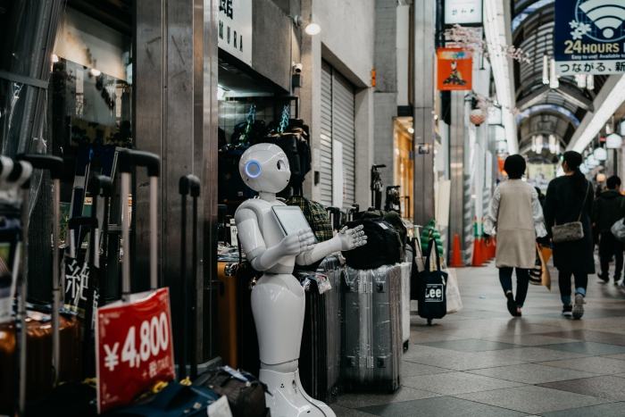 White Robot at the streets of Japan holding menu