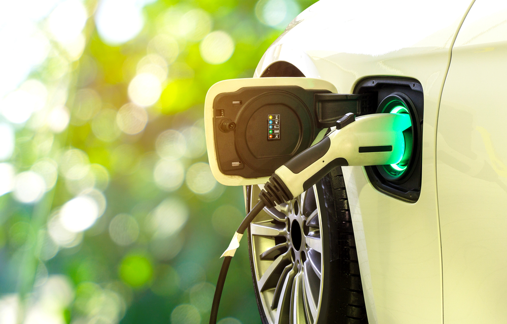 white electric car that is charging