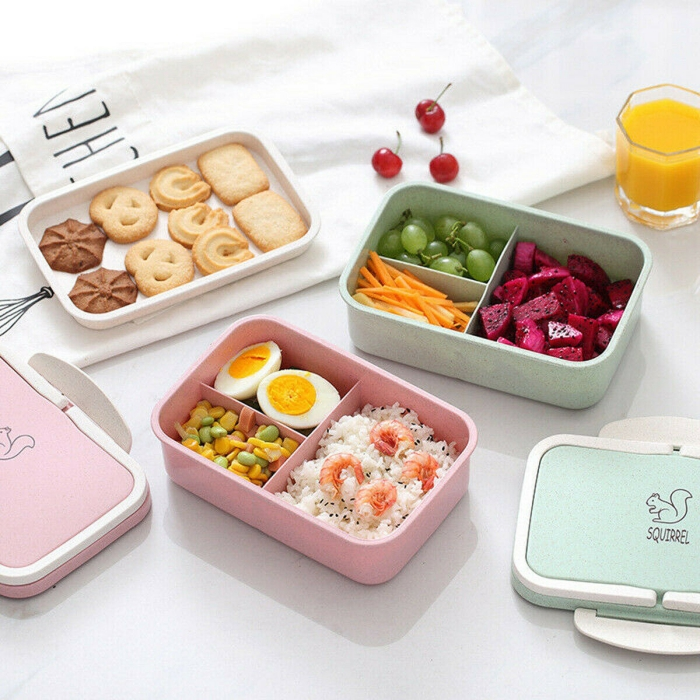 Large Bento Box stackable colorful containers on a white table
