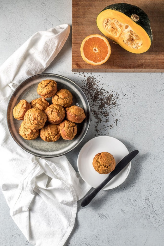 vegan ideas pumpkin muffins with orange and pumpkin on a white table
