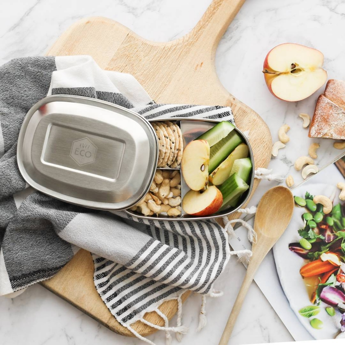 Stainless Steel Adult Lunch Box healthy meal with vegetables nuts and fruits on a kitchen table