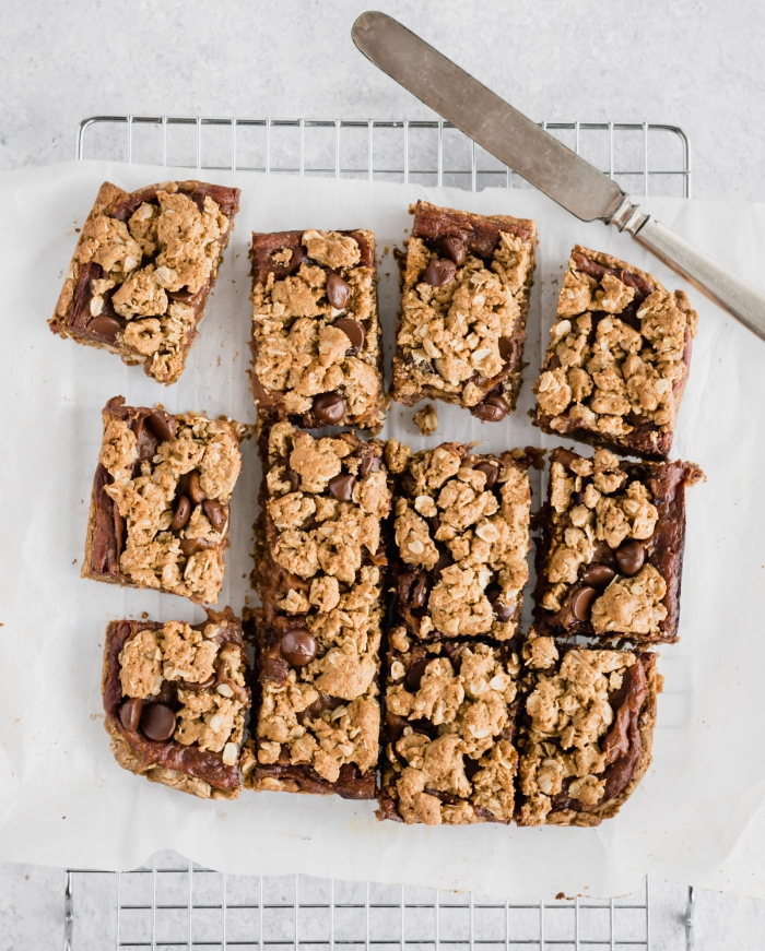 vegan chewy energy bars cut into squares with a knife