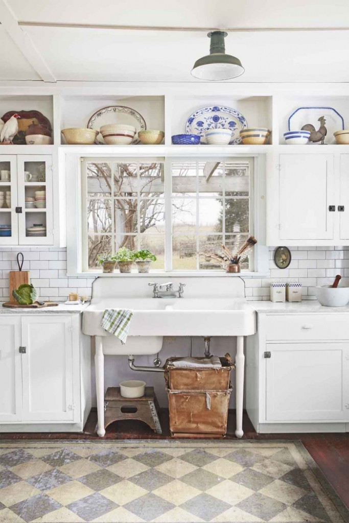 Vintage White Kitchen with small window and colorful ceramic plates