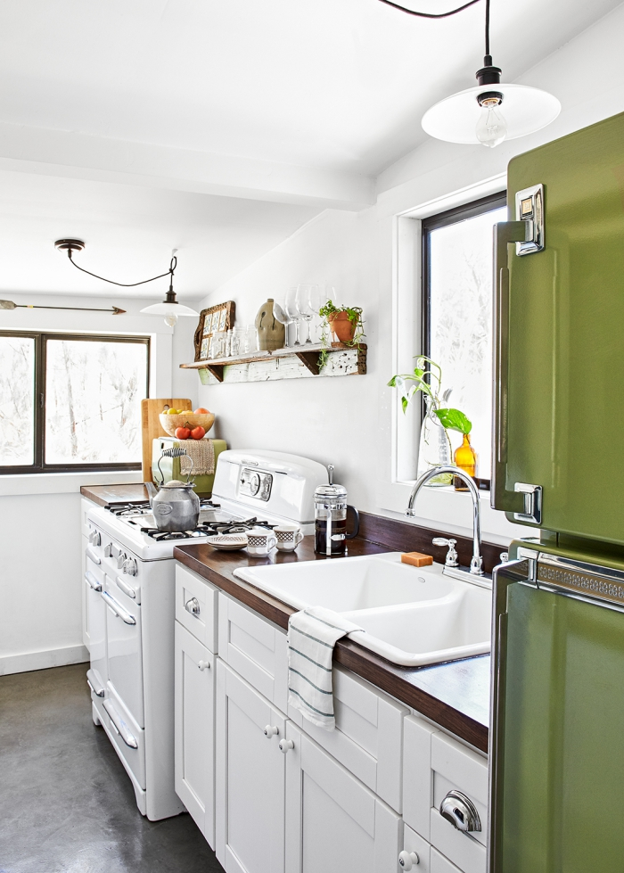 small white kitchen with green refrigerator low ceiling