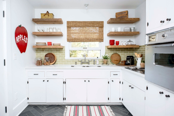 Vintage White Kitchen with natural materials, red accents and dark tile floor