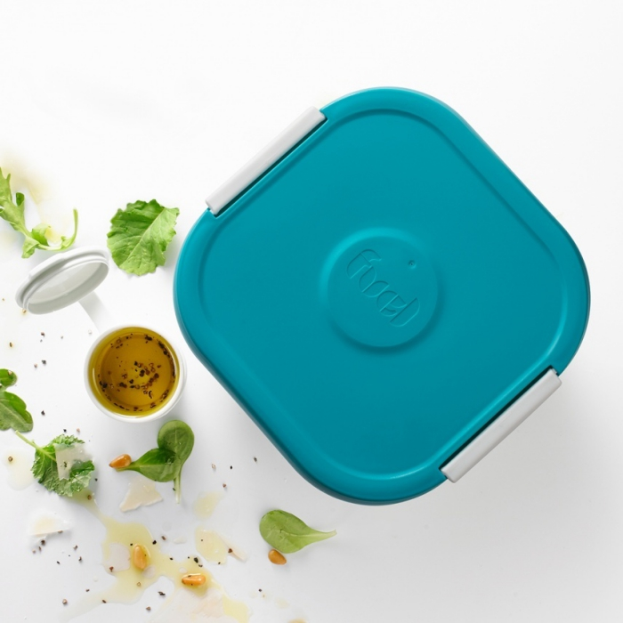 salad container for lunch with a dressing tray with blue lid on a white background