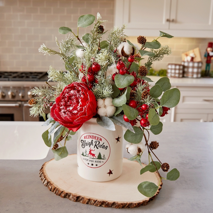 Beautiful Floral Christmas table centerpiece red flowers cotton berries leaves in a kitchen