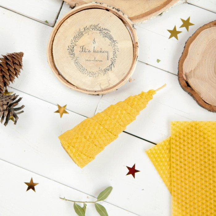 eco-friendly gift ideas beeswax candles on a white table Christmas decor