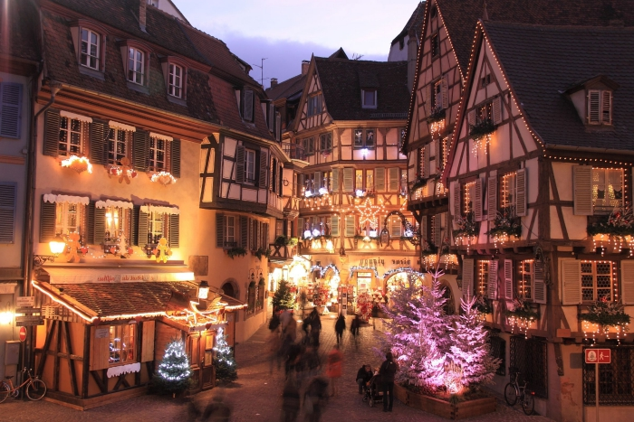 Strasbourg Christmas Market small streets festive atmosphere christmas lights and trees typical houses