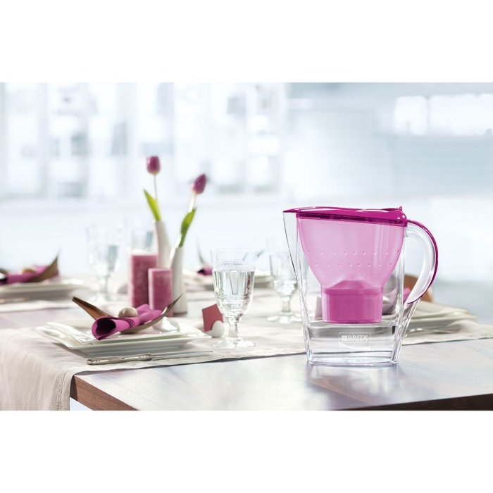 Water filter jug pink inside on a table